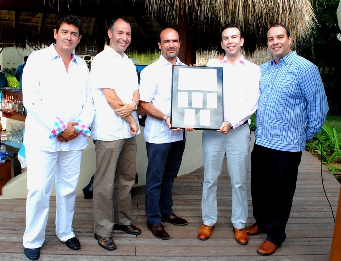 Breathless Punta Cana Managing Director Ricardo Dominguez and staff accept the RCI Gold Crown Award.