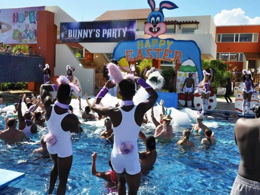 Guests enjoy the Bunny Pool Party at Breathless Punta Cana Resort & Spa.