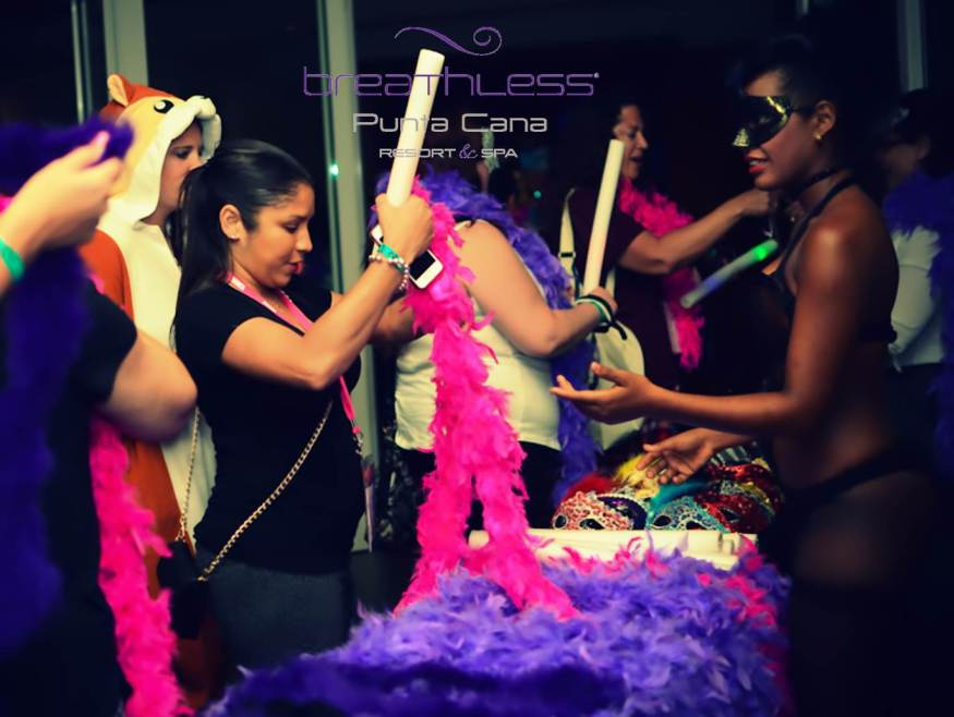 Guests grab their fun accessories for a great night at Breathless Punta Cana.