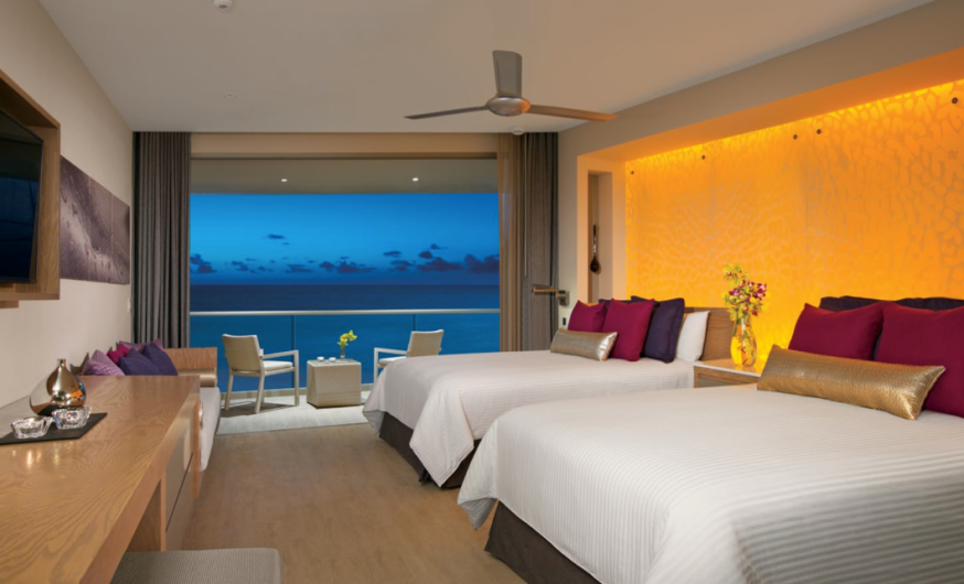A Junior Suite featuring double beds at Breathless Riviera Cancun Resort & Spa.